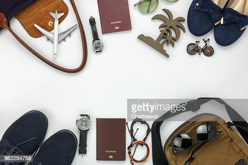 Top view of items for travel with fashion men & women background concept.Difference essential accessory on the white wood area.Copy space for creative font or text design.Objects for traveler on trip. : Stock Photo