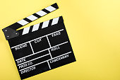 top view of movie clapper board on yellow