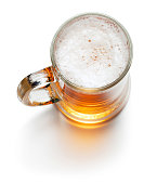 top view of mug of light beer isolated on white background