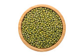 Top view of mung bean in wooden bowl isolated on white background with clipping path