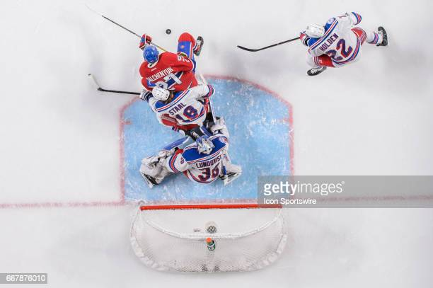 Top view of New York Rangers goalie Henrik Lundqvist following the puck with Montreal Canadiens center Alex Galchenyuk and New York Rangers...
