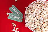 Top view of popcorn and movie tickets