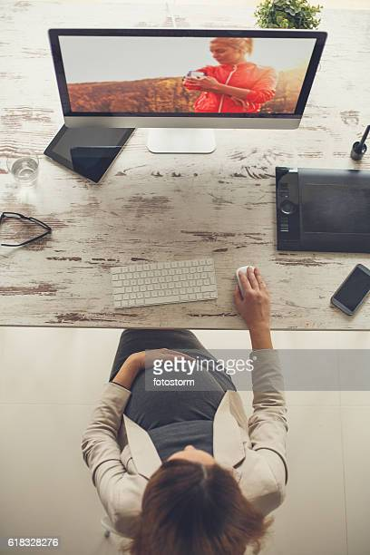 Top view of pregnant woman working on the computer