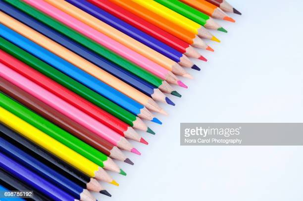 Top view of row of colorful pencils