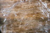 top view of rustic wooden table covered with flour
