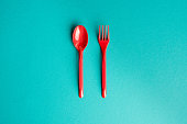 top view of set of plastic fork and spoon isolated on blue