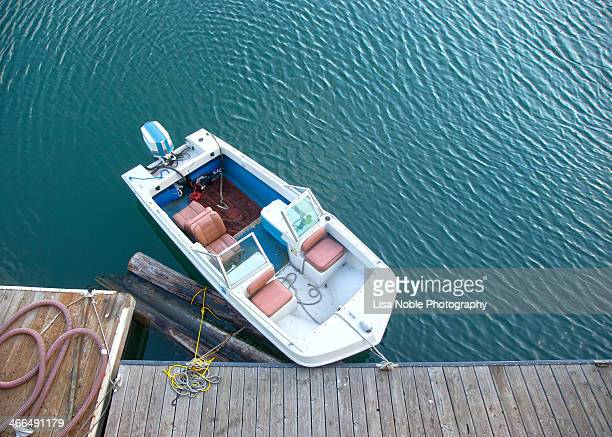 Top View of Small Power Boat against Blue Water