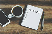 Smart phone, coffee, pen and notepad with text ' to do list', retro style