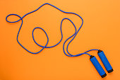 top view of sports jumping rope isolated on orange, sport background concept