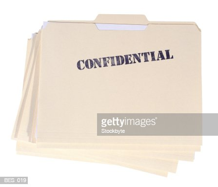 Top view of stack of file folders marked Confidential