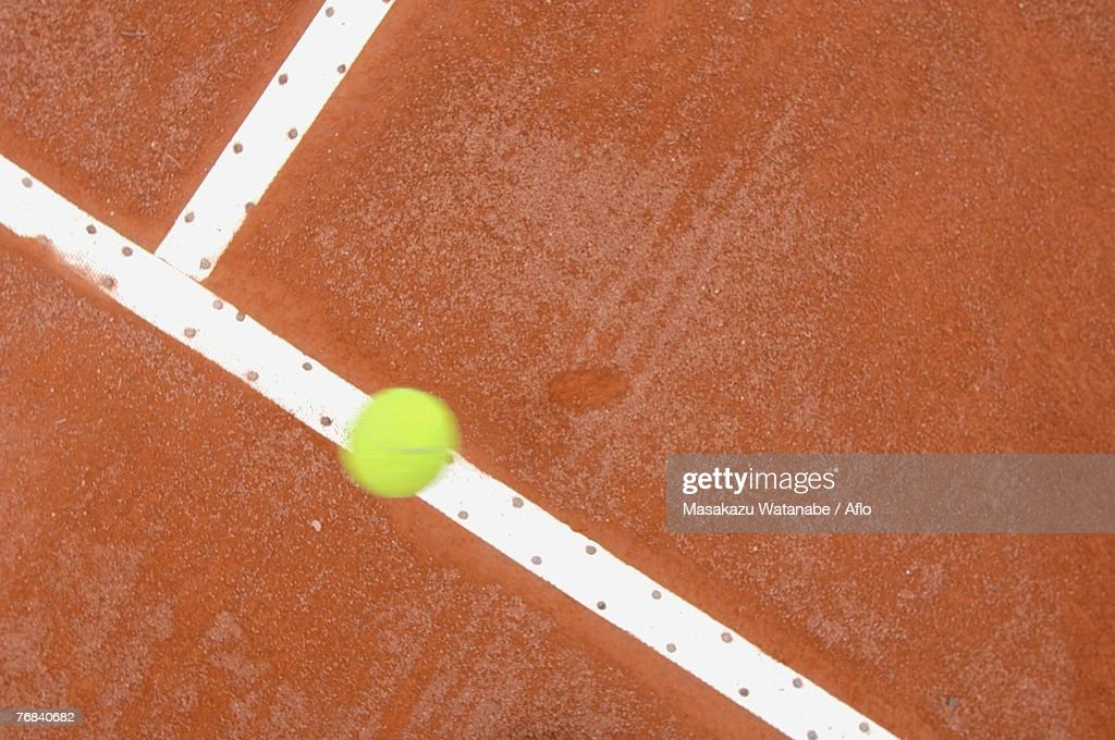 Top View of Tennis Ball Hitting Court Line : Photo