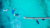 top view of tourist speed boat approaching to floating port in phuket island andaman sea thailand
