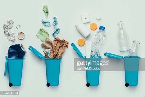 top view of trash bins and assorted garbage isolated on grey, recycle concept : Stock Photo