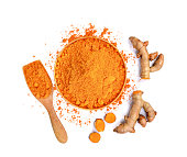 top view of turmeric roots and turmeric powder in wooden bowl isolated on white background