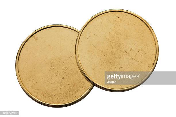 Top view of Two generic used blank coins on white