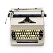Top view of a 70s portable typewriter isolated on white background, contains clipping path.