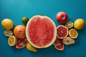 top view of watermelon, grapefruits and lemons on blue surface