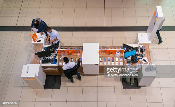 Top view of Wind mobile kiosk with customers and attendants standing around it