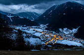 top view on snowy village Luesen  with night illumination south tirol Italy  valley village landscape between the mountains