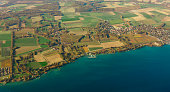Top view on the city many small houses on the coast of the lake ohrid with docks and moored ships old city and waterfront in switzerland