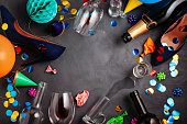 Top view shot of after a party celebration with empty bottles,wine glass, girl shoes and party accessories