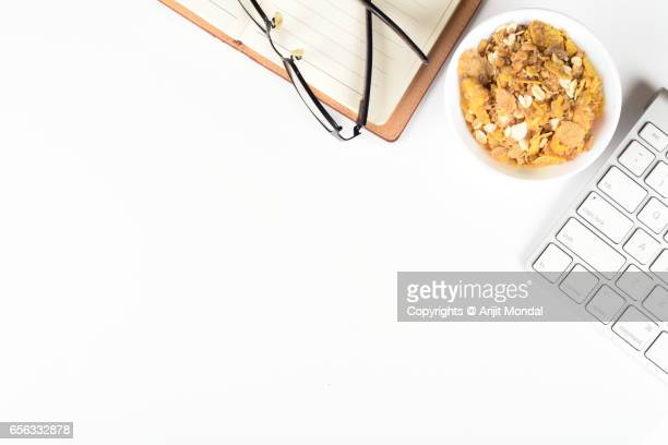 Top View Shot Of Breakfast Cereal With Computer Keyboard on Office Desk