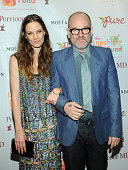 Topaz PageGreen and Michael Stipe attend the 2012 Lunchbox Fund Bookfair auction at Del Posto on March 21 2012 in New York City