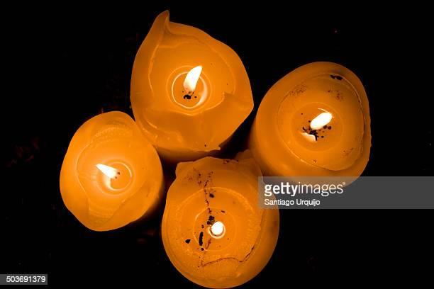 Top-down view illuminated candles at night