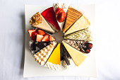 Topdown view of cakes, strawberry, cheese, chocolate, blue berry, coffee cakes taken outdoor with natural lights