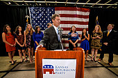 Topeka Kansas 1142014 Governor Sam Brownback and his running mate Lt Governor Jeff Colyer and their families on stage at the Republican party victory...