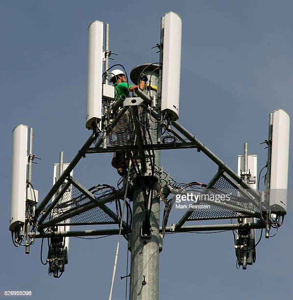 Topeka Kansas 5232014 Cell phone tower being worked on by tech to perform routine maintenance Replacing cell phone nodes Credit Mark Reinstein
