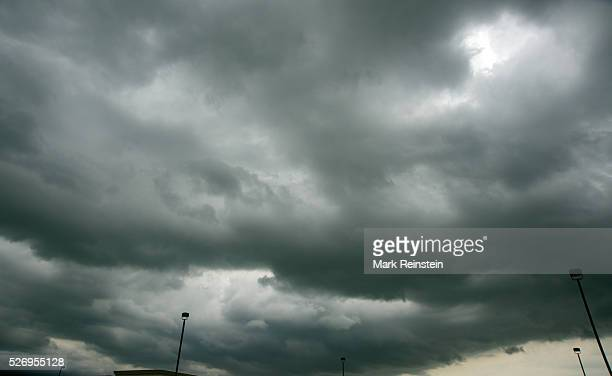 Topeka Kansas 5232014 Clouds forming overhead from a thunderstorm In meteorology a cloud is a visible mass of liquid droplets or frozen crystals made...