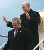 US President George W Bush walks down the stairs of Air Force One followed by US Senator Pat Roberts RKS after landing 23 January 2006 in Topeka...
