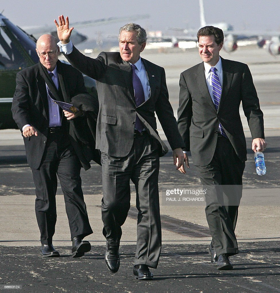 US President George W. Bush walks with US Senators <a gi-track='captionPersonalityLinkClicked' href=/galleries/search?phrase=Pat+Roberts&family=editorial&specificpeople=213805 ng-click='$event.stopPropagation()'>Pat Roberts</a> (R-KS) and Sam Brownback (R-KS) on the tarmac at the Kansas Air National Guard 190th Refueling Wing in Topeka, Kansas, as they return to Air Force One for the trip back to Washington, after Bush delivered remarks on the war on terror 23 January 2006 at Kansas State University in Manhattan, Kansas. AFP PHOTO/Paul J. RICHARDS