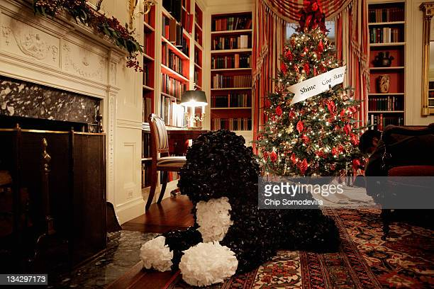 A topiary of the first family's dog Bo made from plastic sits in front of the fire place in the Library during the first viewing of the 2011 White...