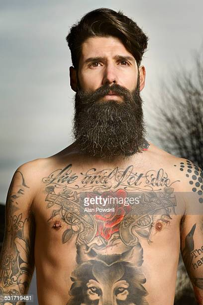 Topless bearded man with Tattoos