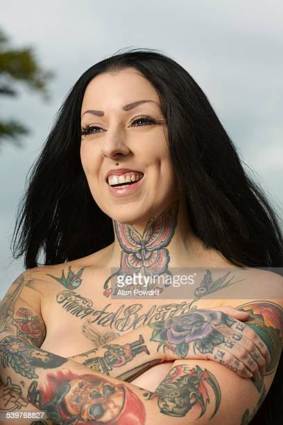 Topless female portrait with tattoos