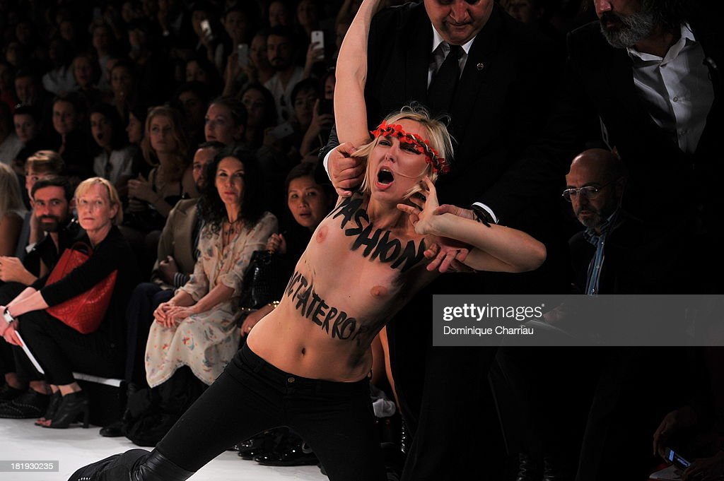 A topless Femen activist disrupts the Nina Ricci show during Paris Fashion Week Womenswear Spring/Summer 2014 on September 26, 2013 in Paris, France.