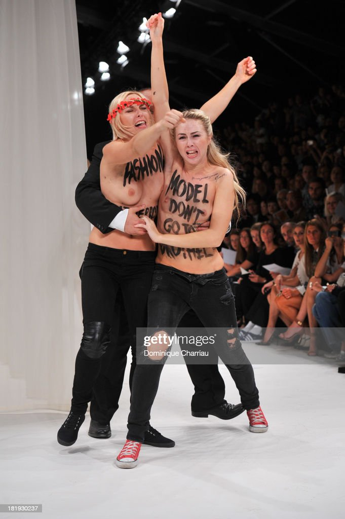 Topless Femen activists disrupt the Nina Ricci show during Paris Fashion Week Womenswear Spring/Summer 2014 on September 26, 2013 in Paris, France.