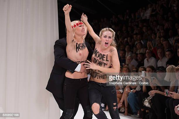 Topless Femen activists disrupt the Nina Ricci show during Paris Fashion Week Womenswear Spring/Summer 2014 in Paris