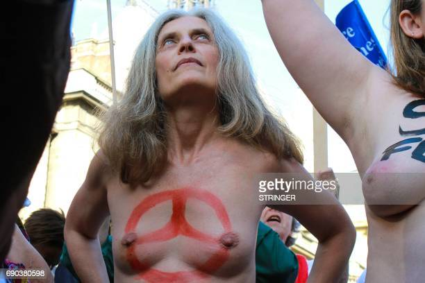 Topless Femen activists stand outside the courthouse where Femen activists go on trial for showing their breasts during a protest at a rally against...