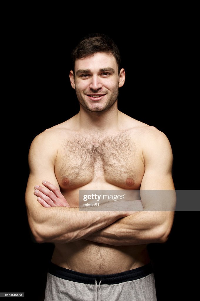 Topless man  isolated on a black background : Stock Photo