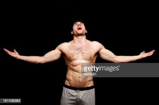 Topless man shouting with his arms outstretched : Stock Photo