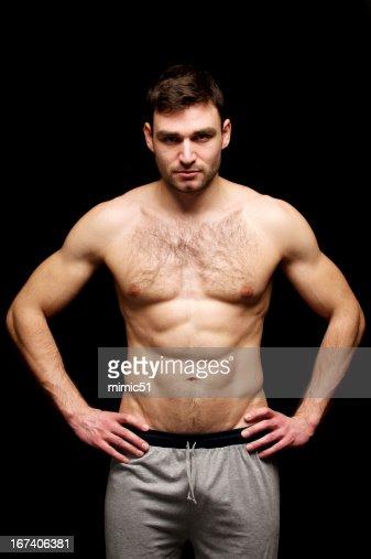における上半身裸の男た絶縁、黒色の背景 : ストックフォト