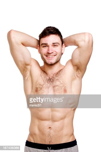 Topless man stood isolated on a white background : Bildbanksbilder