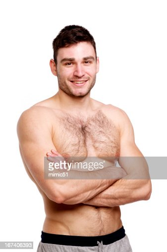 Topless man stood with his arms folded : Bildbanksbilder