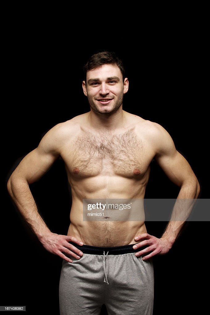 Topless man stood with his hands on hips : Stock Photo