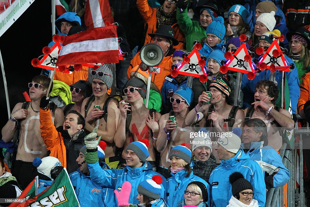 Topless members of the Carmen Thalmann fan club watch from the stands during the Audi FIS Alpine Ski World Cup Slalom race on January 15, 2013 in Flachau, Austria,