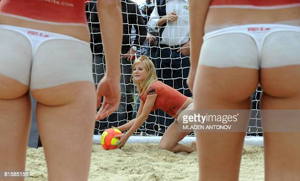 Topless porn actresses wearing bodypaint with Austrian colours play a beach football game on a beach in Vienna on June 15 a day before the European...