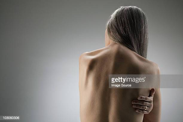 Topless senior woman, rear view